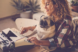 Woman with Pug Typing